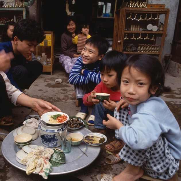Dining out on the streets of Hanoi is a local family affair